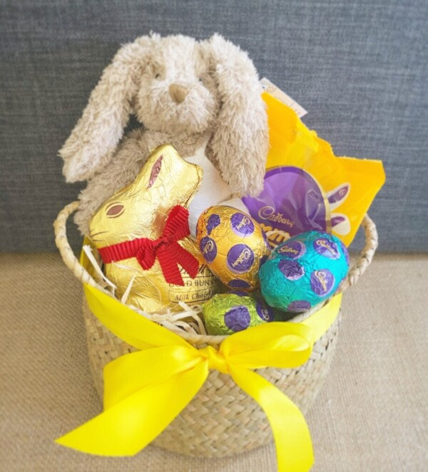 Little Bunny Easter Basket is a gorgeous treat! A Baby honey bunny soft toy from Nana Huchy, a selection of easter eggs all tied up in a reusable basket.