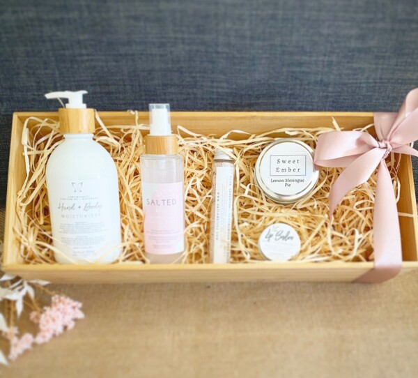 Wellness Gift Hamper is a little bit of luxury in a box. Includes a selection of body care items from salted bliss and a Sweet Ember candle gift wrapped in a re-usable wooden box.